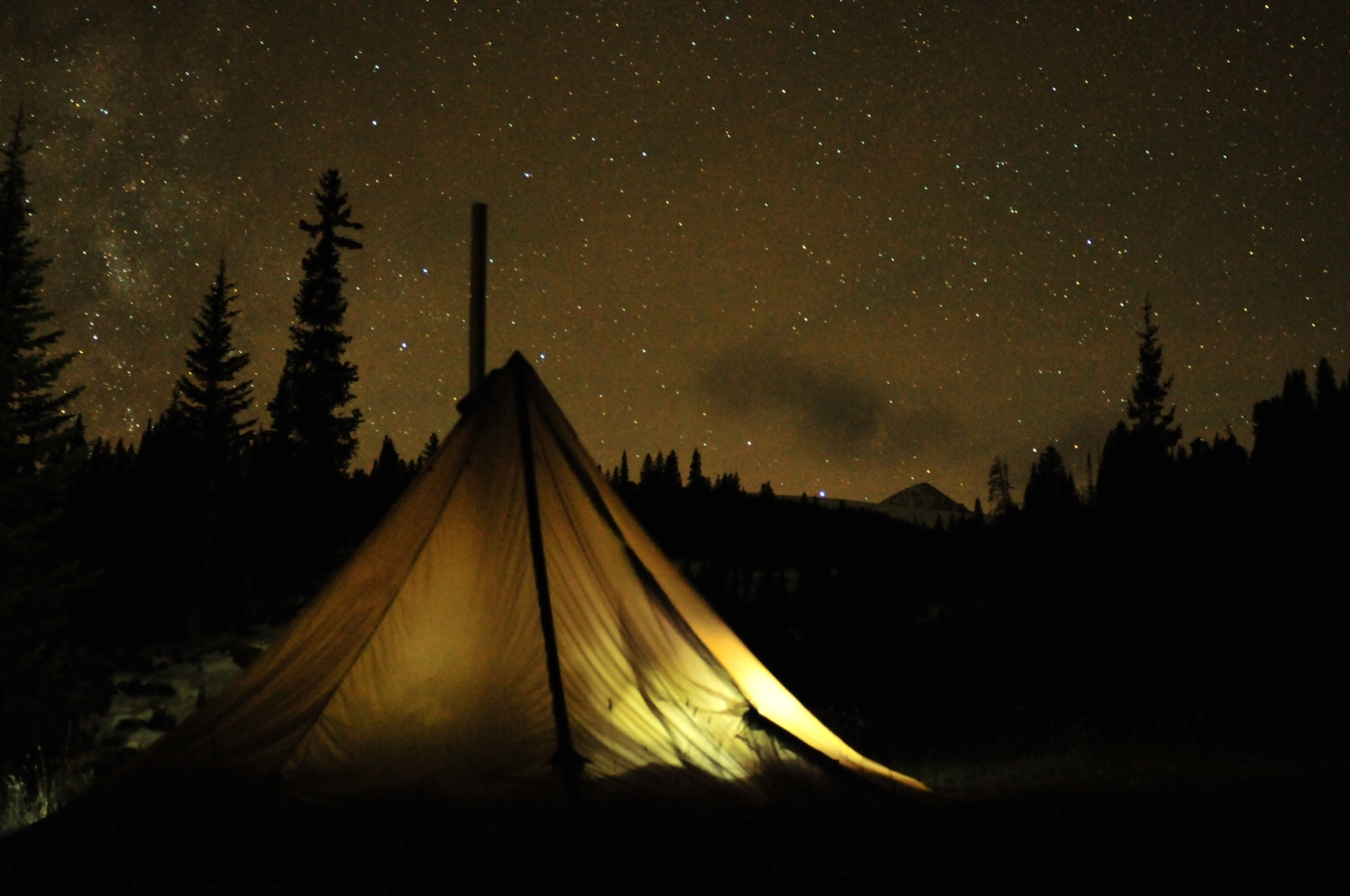 Winter Camping: How to build a DIY tipi and wood burning